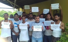 Bangladeshi migrant workers hold signs requesting help and support after they are stranded in Vanuatu. Photo credit: Vanuatu Daily Post
