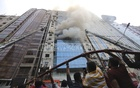 Fire crew working to douse the fire at the FR Tower in Dhaka's Banani on Thursday. Photo: Asif Mahmud Ove