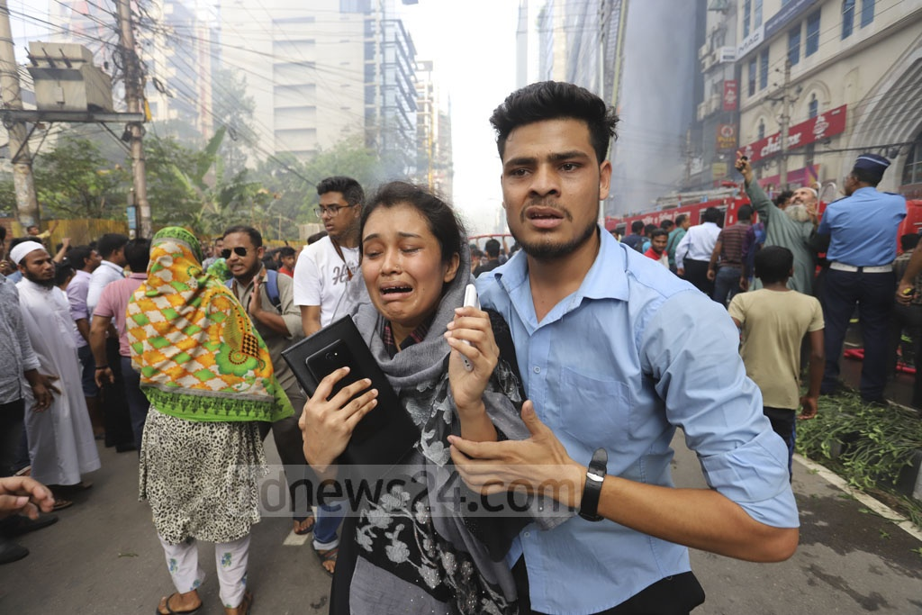 Relatives crying for dear ones as many were trapped inside the FR Tower in Dhaka's Banani during a fire incident on Thursday. Photo: Asif Mahmud Ove