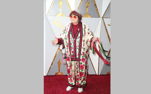 FILE — Agnès Varda, the acclaimed French filmmaker, on the red carpet at the Oscars in Los Angeles, Mar 4, 2018. Varda, an emblematic feminist and cinematic firebrand whose innovations predated the work many other filmmakers in the New Wave movement which she was often identified with, died at home in Paris on Mar 29, 2019. She was 90. (Josh Haner/The New York Times)
