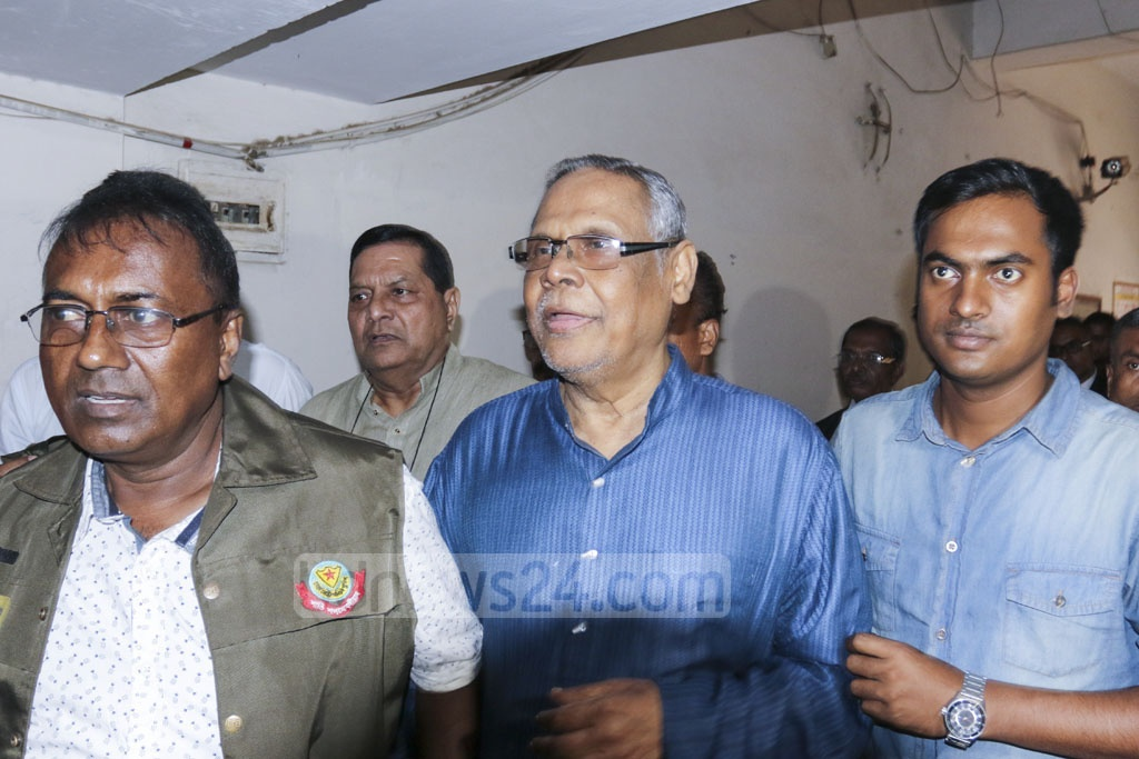 Police escorting Tasvir Ul Islam, the chief of the panel of owners that manages the FR Tower, and SMHI Faruque (front), the owner of the land, on Sunday to a Dhaka court which sent them to two days of remand for grilling in a case over a deadly fire in the high-rise at Banani.