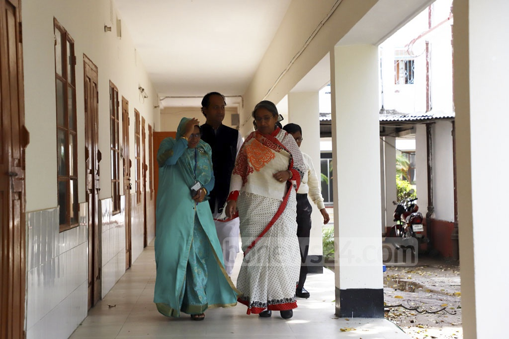 Education Minister Dipu Moni along with Deputy Minister Mohibul Hassan Chowdhoury Nowfel walks through Siddheswari Girls College centre's corridor on the first day of HSC exams on Monday. Photo: Abdullah Al Momin