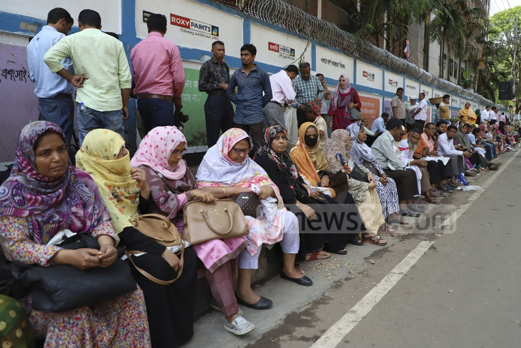 Guardians waiting at the Notre Dame College centre on Monday, the first day of HSC exams. Photo: Abdullah Al Momin