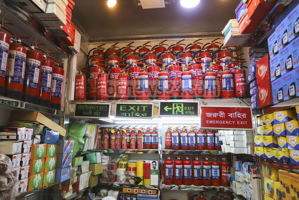 Fire extinguishers on display at a Nawabpur wholesale market shop in Dhaka on Tuesday. Photo: Asif Mahmud Ove
