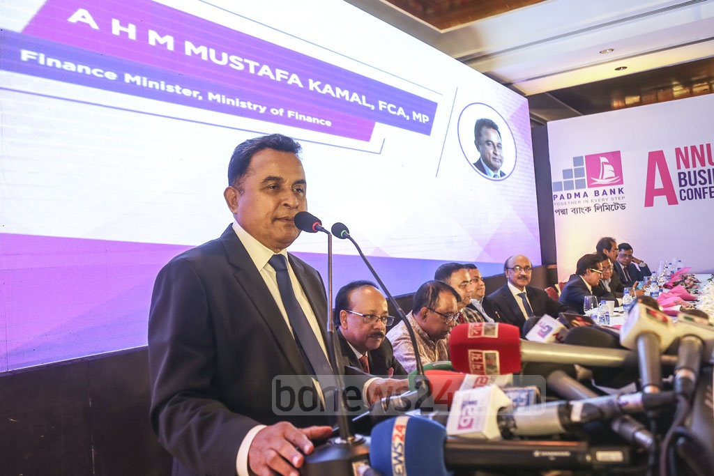 Finance Minister AHM Mustafa Kamal speaking at the first annual business conference of the Padma Bank at a Dhaka hotel on Tuesday. Photo: Mahmud Zaman Ovi
