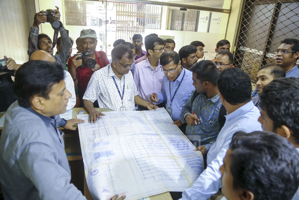 A RAJUK team checking the design of Erectors House, a building on Kamal Ataturk Avenue in Banani, on Tuesday as part of a drive to find out faults in construction, design and fire safety systems in the buildings in Dhaka. Photo: Mahmud Zaman Ovi