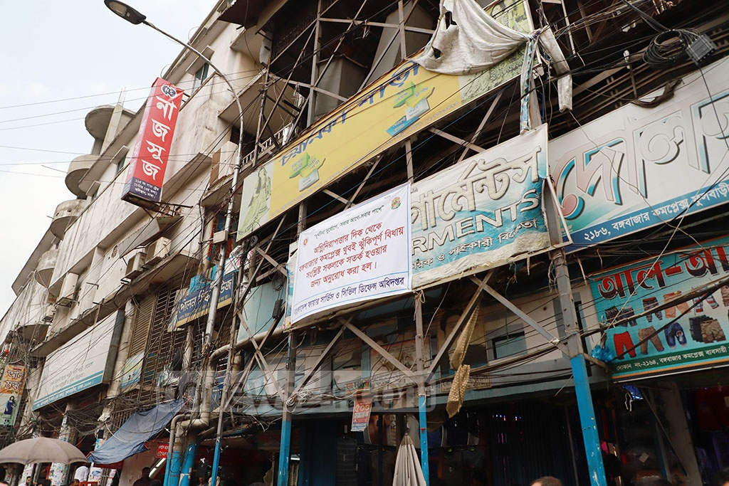 Fire Service and Civil Defence has hung notices in Dhaka cautioning the people about high-rises, markets and business organisations vulnerable to fire incidents. This photo was taken from the Bangabazar area on Tueesday. Photo: Abdullah Al Momin