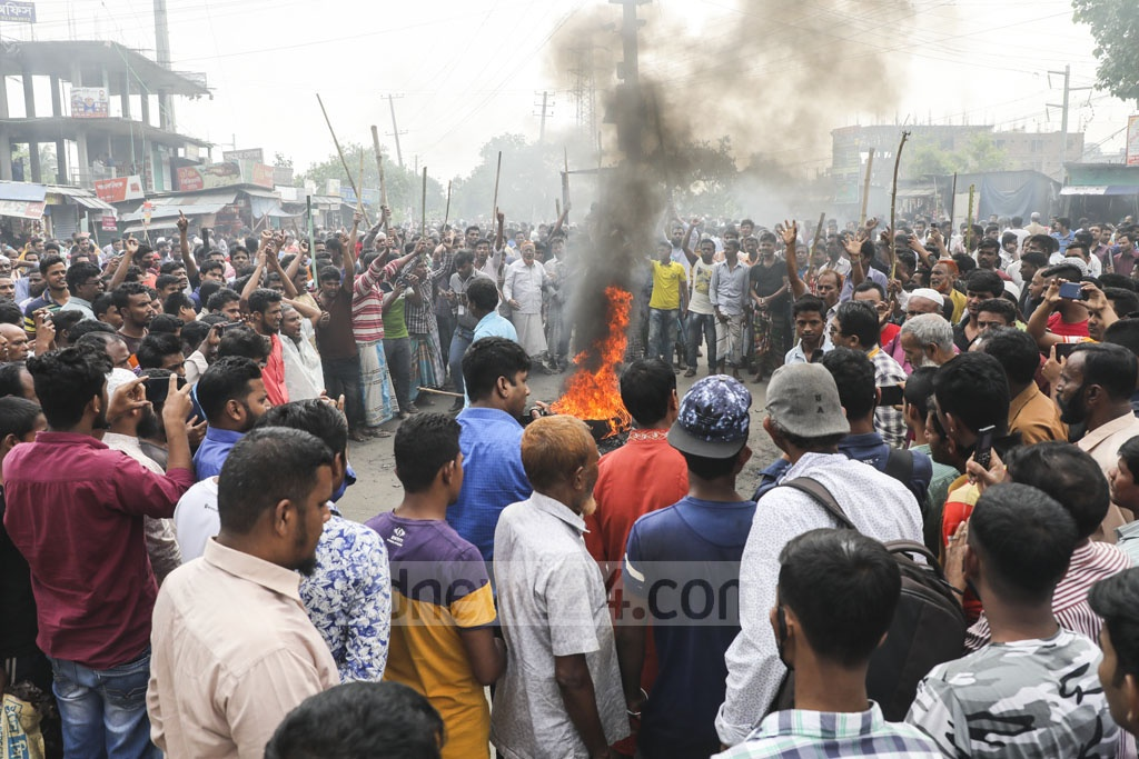 Jute mill workers set fire to a tyre during demonstrations blocking the Dhaka-Sylhet Highway at Demra in the capital for the second day on Wednesday for a nine-point charter of demand, including payment of dues.
