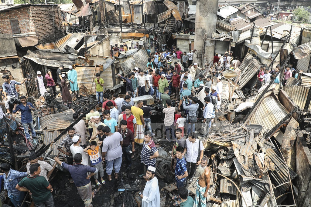 More than 50 shops were gutted in a fire that swept through the Kamarpotti market near the Khilgaon Rail Gate in Dhaka on Thursday.