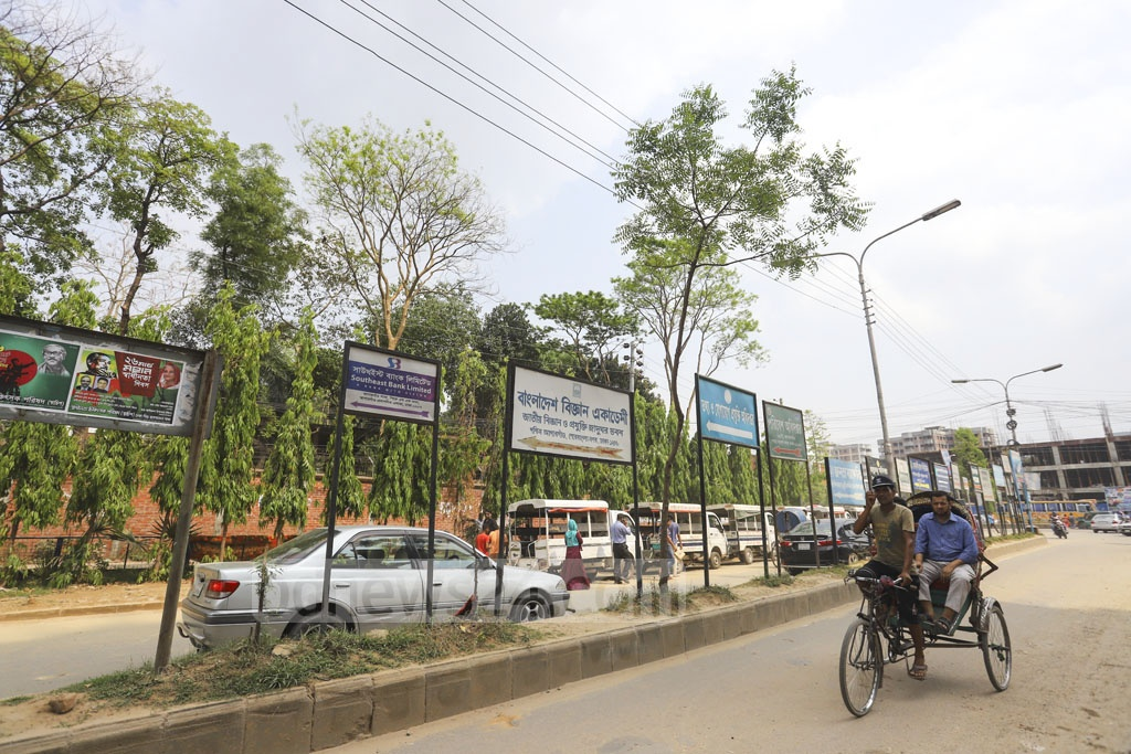 Signboards of different organisations block trees from view on the Agargaon-Mirpur Link Road. Photo: Asif Mahmud Ove