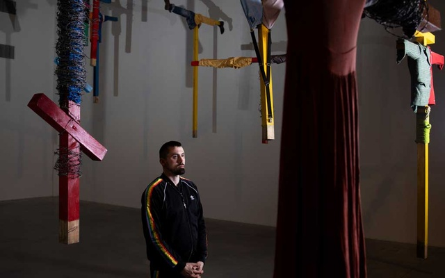 "Daniel Rycharski, a gay artist who makes large sculptural installations filled with religious and rural symbolism, with his ""Strachy"" artwork at the Museum of Modern Art in Warsaw, Poland, Mar 26, 2019. The New York Times"