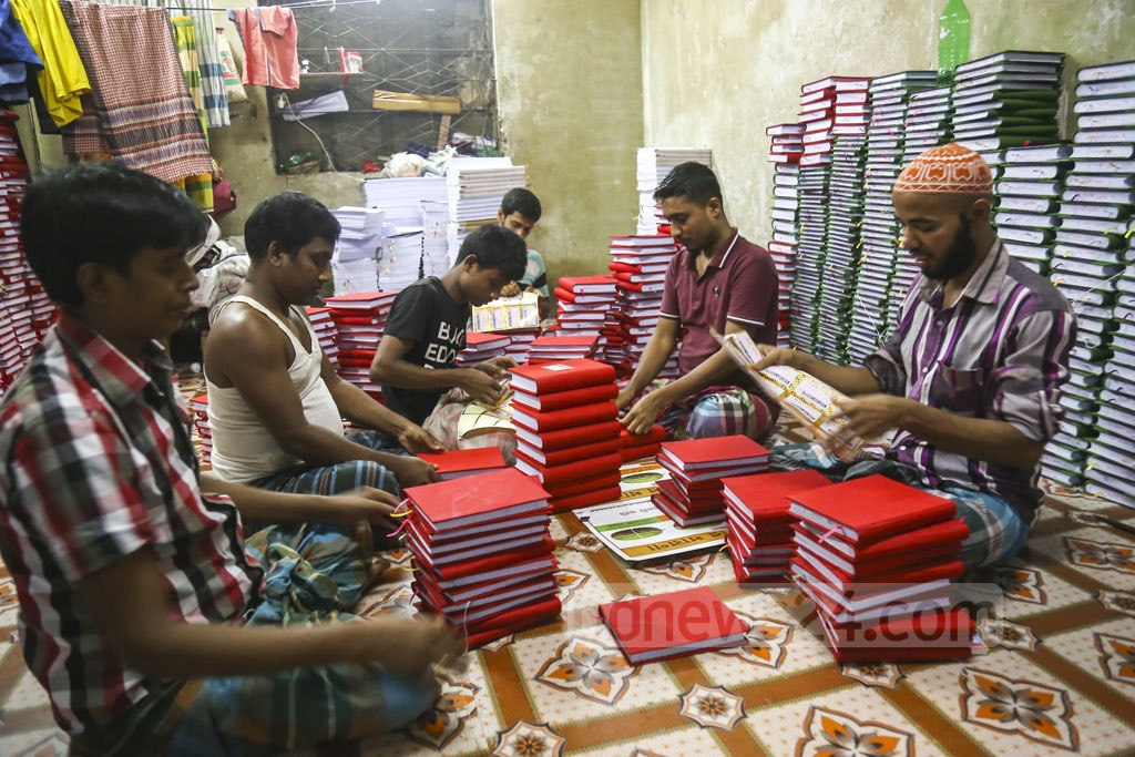 Workers making ledgers for Halkhata at a factory on Syed Hasan Ali Lane at Babu Bazar in Old Dhaka on Sunday ahead of the start of the Bangla New Year 1426. Photo: Mahmud Zaman Ovi