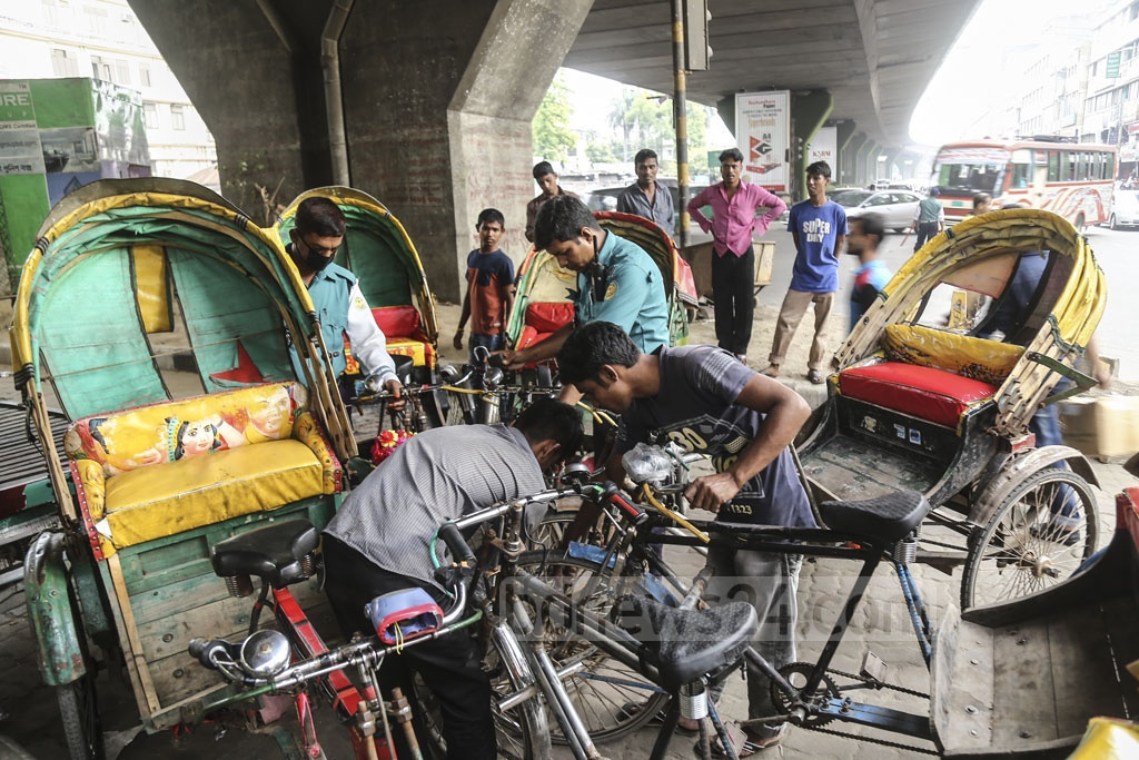 Battery-run rickshaws are banned but are very much common in Dhaka. On Sunday, police seized some of these three-wheelers and locked those at Mohakhali. Photo: Mahmud Zaman Ovi