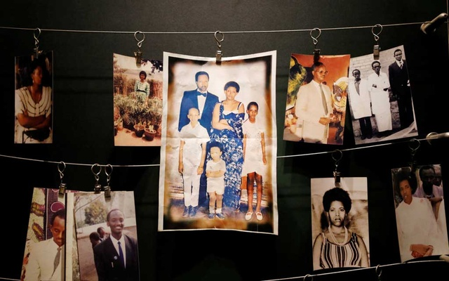 Pictures of the Rwandan Genocide victims donated by survivors are displayed at an exhibition at the Genocide Memorial in Gisozi in Kigali, Rwanda Apr 6, 2019. REUTERS