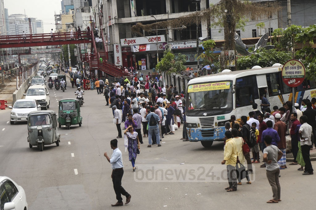 Commuters waited for hours on end for transport in Dhaka as the number of public transport shrunk due to mobile court drives at different places on Sunday. This photo was taken from Farmgate. Photo: Mahmud Zaman Ovi