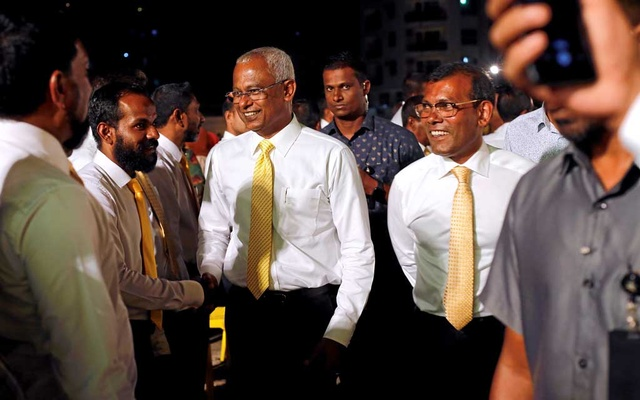 Maldives President Ibrahim Mohamed Solih and former president Mohamed Nasheed arrive at an election campaign rally ahead of their parliamentary election on Saturday, in Male, Maldives April 4, 2019. Reuters