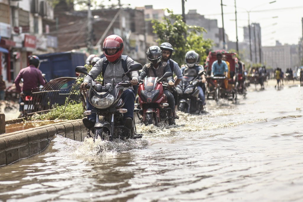 Purabi-Kalishi road in Dhaka's Mirpur goes under water fter rains – no matter light or heavy shower. This photo of the road was taken on Tuesday after moderate rains. Photo: Mahmud Zaman Ovi