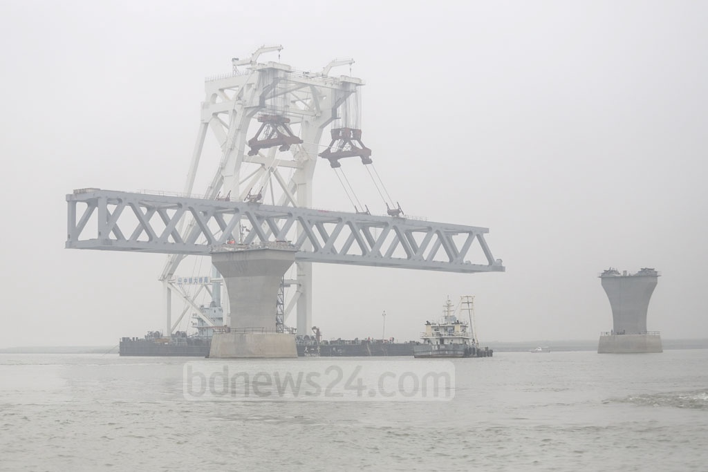 The 10th span of the Padma Bridge was brought from a construction yard at Kumarbhog by a floating crane to Mawa end for installation on Wednesday. Photo: Abdullah Al Momin