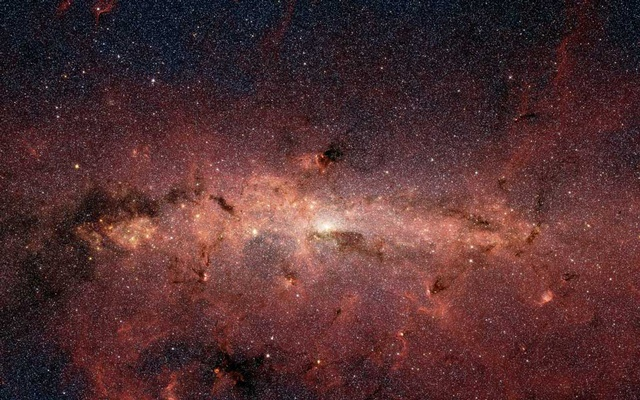 An image provided by NASA and JPL-Caltech shows the Milky Way galaxy. The brightest white spot in the middle is the very centre of the galaxy, which also marks the site of a supermassive black hole. Scientists were able to capture an image of a black hole for the first time in April 2019. (NASA/JPL-Caltech via The New York Times)