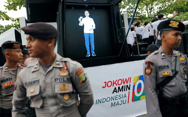 FILE PHOTO: Hologram of Indonesia's presidential candidate Joko Widodo is seen at a carnival during a campaign rally in Tangerang, Banten province, Indonesia, April 7, 2019