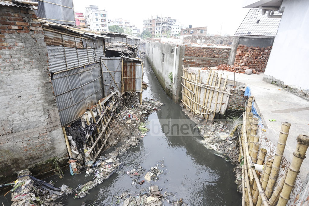Illegal structures are built by encroaching on Paris Road Khal canal in Mirpur. Photo: Asif Mahmud Ove