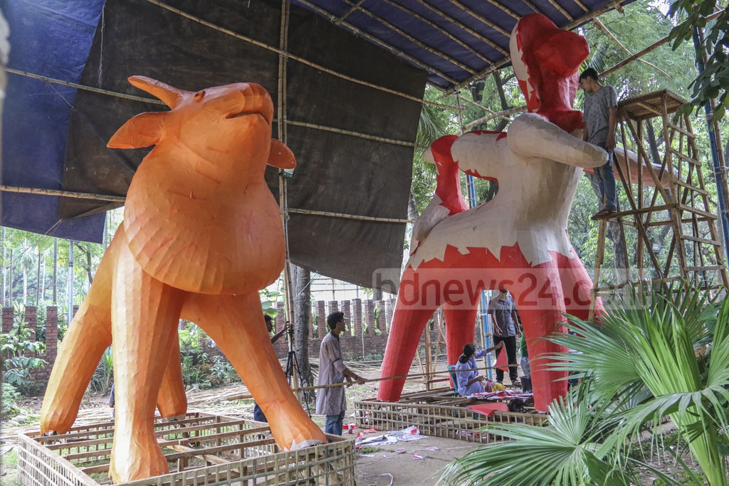 Students of Dhaka University's Faculty of Fine Arts make final preparations for Pahela Baishakh celebrations on the eve of Bangla New Year on Saturday. Photo: Abdullah Al Momin