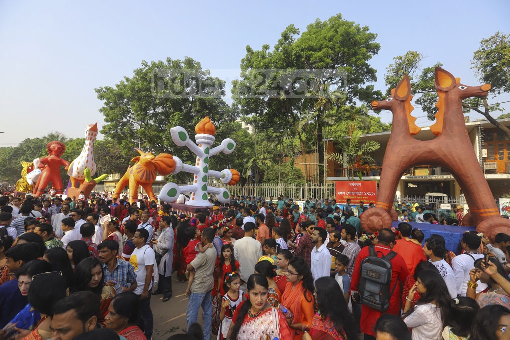 The Fine Arts Faculty of Dhaka University marks the Bangla New Year 1426 by arranging the Mangal Shobhajatra with the theme 'Mastak tulite dao ananta akashe' (Let us raise our heads towards the limitless skies).