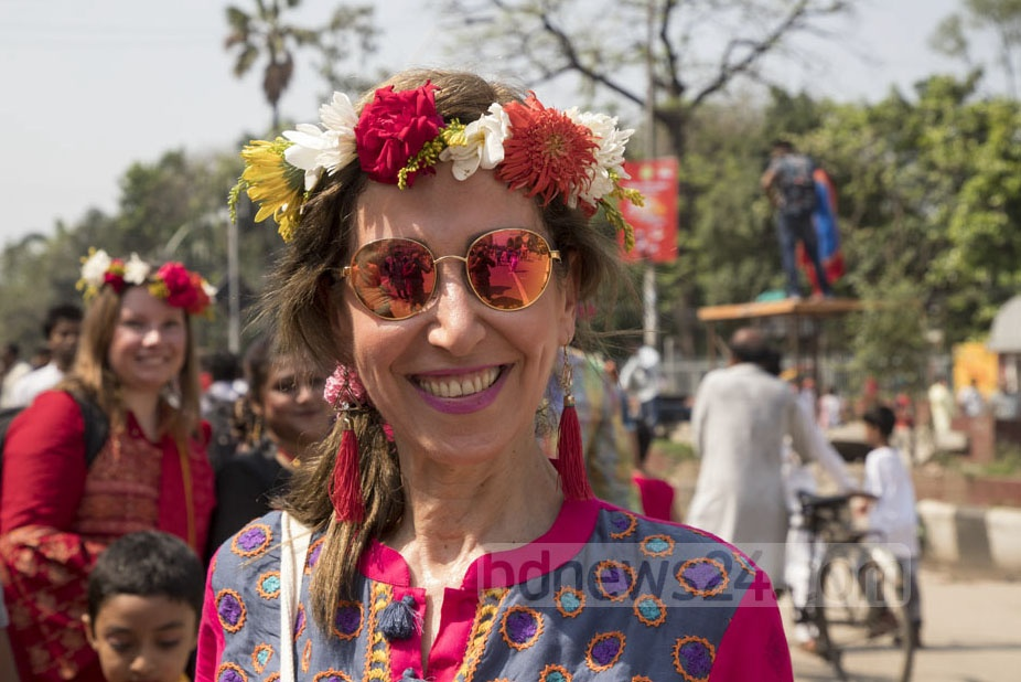 Foreigners clad in Baishakh-themed attires take part in the Mangal Shobhajatra.