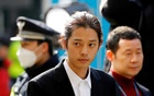 South Korean singer Jung Joon-young arrives for questioning on accusations of illicitly taping and sharing sex videos on social media, at the Seoul Metropolitan Police Agency in Seoul, South Korea, Mar 14, 2019. REUTERS