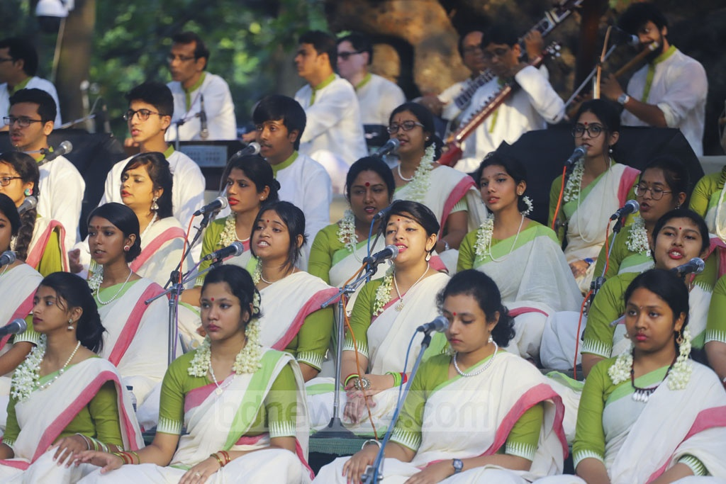 The first sunrise of Baishakh is greeted with a chorus of songs and poetry recitations at Chhayanaut's Pahela Baishakh celebrations in Ramna Batamul. Photo: Asif Mahmud Ove