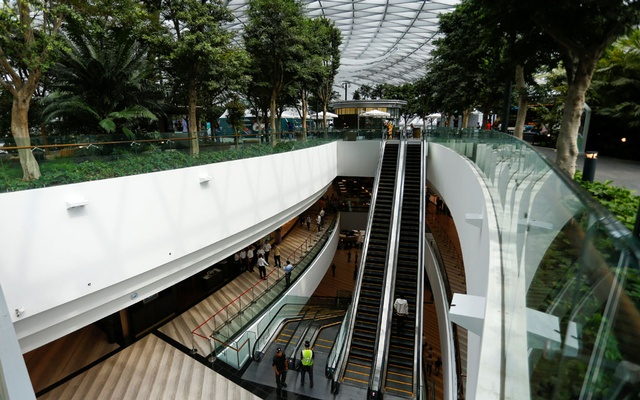 An escalator from a shopping floor leading up to the Canopy Park of Jewel Changi Airport is pictured in Singapore, April 11, 2019. Reuters
