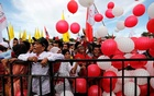 FILE PHOTO: Supporters throw balloons as they attend a campaign rally of Indonesia's presidential candidate for the next general election Joko Widodo at a stadium in Serang, Banten province, Indonesia, Mar 24, 2019. REUTERS