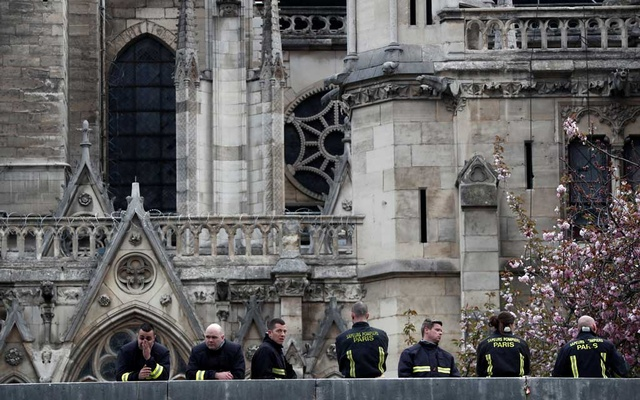 Firefighters work at Notre-Dame Cathedral after a massive fire devastated large parts of the gothic gem in Paris. REUTERS