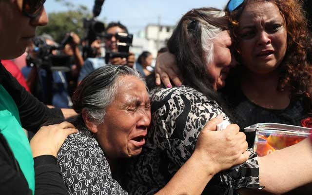 Supporters of Peru's former President Alan Garcia react after the announcement that Garcia died in a hospital after shooting himself, in Lima, Peru April 17, 2019. Reuters