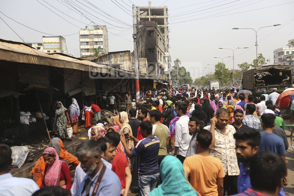 Onlookers gathered outside the Malibagh Kitchen Market in Dhaka after a fire incident early in the morning. Photo: Mahmud Zaman Ovi