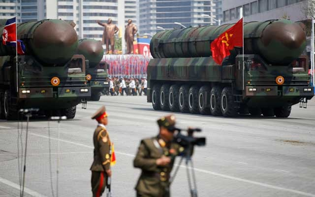 FILE PHOTO: Intercontinental ballistic missiles (ICBM) are driven past the stand with North Korean leader Kim Jong Un and other high ranking officials during a military parade marking the 105th birth anniversary of country's founding father Kim Il Sung, in Pyongyang April 15, 2017. REUTERS