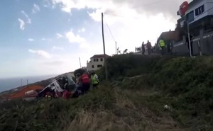 A site of a bus accident is seen in Canico, in the Portuguese Island of Madeira, April 17, 2019 in this still image taken from social media video. Courtesy DIARIO de Noticias da Madeira/via REUTERS