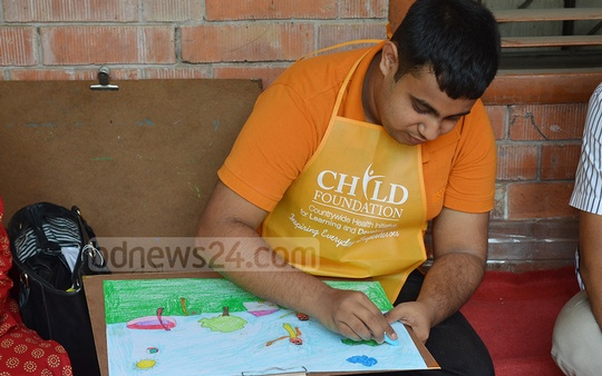 Children with autism painting in the 3rd Art for Autism 2019 organised by the CHILD Foundation in collaboration with the Dhaka University's Faculty of Fine Arts on the campus on Friday.