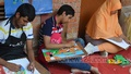Autistic children drawing pictures at an art camp at the Dhaka University's Faculty of Fine Arts on Friday.
