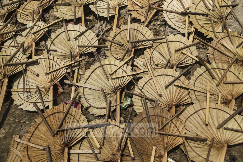 Very few families at Solmaid in Dhaka's Bhatara are engaged in making hand fans now. Photo: Mahmud Zaman Ovi