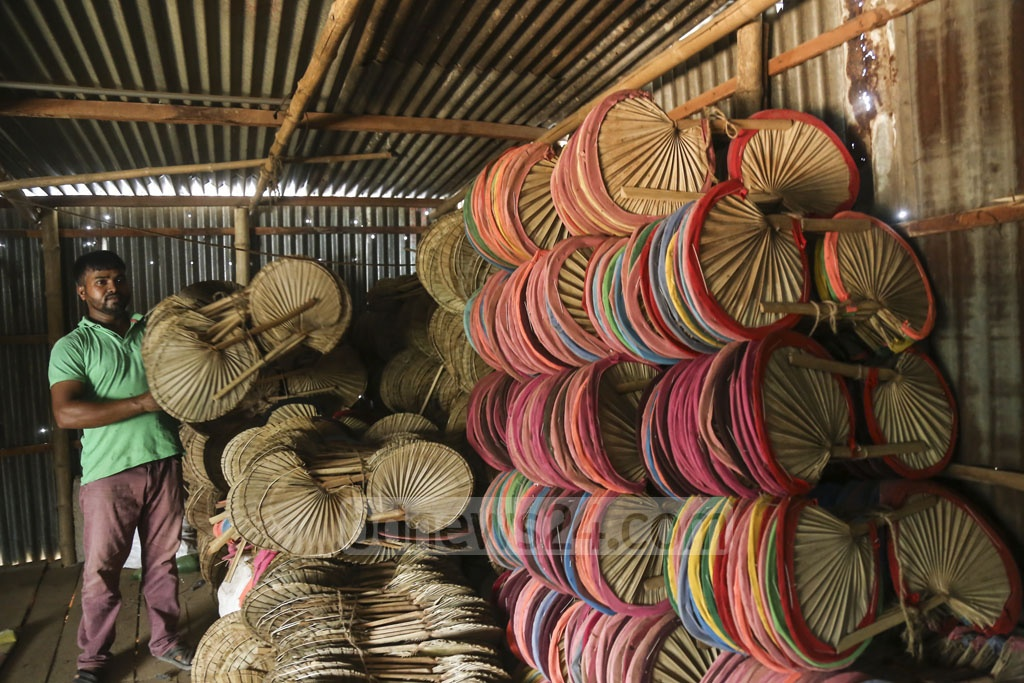 Hand fans are piled up at Solmaid in Dhaka's Bhatara. These will be taken to the market for sale. Photo: Mahmud Zaman Ovi
