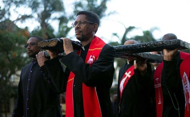 Church leaders carry a cross during a silent march celebrating Good Friday in Durban, South Africa, April 19, 2019. REUTERS