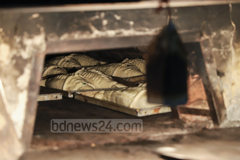 Breads of different shapes and designs are made at a bakery on Nazimuddin Road in Dhaka on the eve of Shab-e-Barat on Saturday. Photo: Abdullah Al Momin