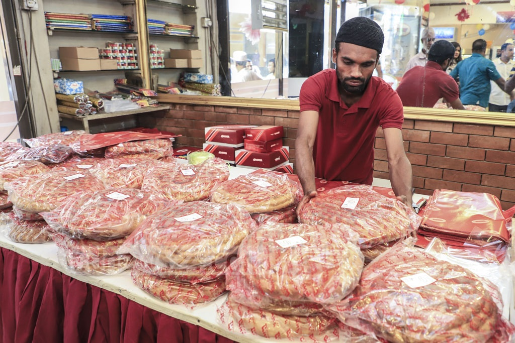 Breads of different designs are on display at Ananda Confectionary on Abul Hasnat Road in Old Dhaka on the eve of Shab-e-Barat on Saturday. Photo: Abdullah Al Momin