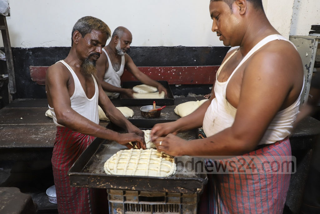 Workers are busy making breads for Shab-e-Barat at a bakery on Abul Hasnat Road in Old Dhaka on the eve of the celebrations on Saturday. Photo: Abdullah Al Momin