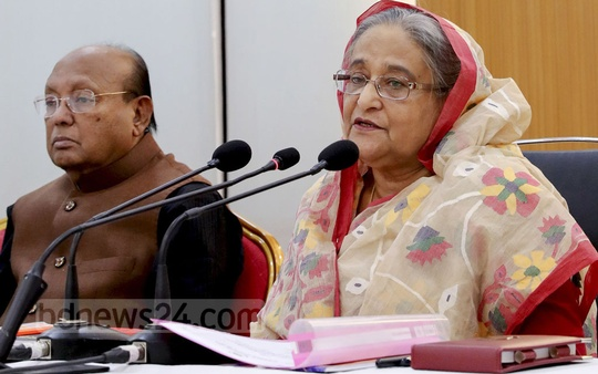 Prime Minister Sheikh Hasina speaks at a joint meeting of the Awami League Central Working Committee and Advisory Council at the party headquarters on Bangabandhu Avenue in Dhaka on Saturday. Photo: Saiful Islam Kallol