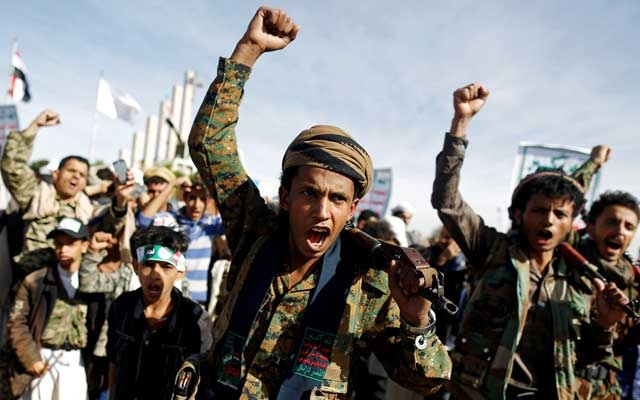 Supporters of the Houthi movement shout slogans as they attend a rally to mark the 4th anniversary of the Saudi-led military intervention in Yemen's war, in Sanaa, Yemen March 26, 2019. REUTERS