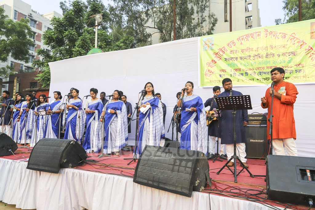 Christian hymns are being sung at a prayer service on the morning of Easter Sunday at the T&T field near Manik Miah Avenue in Dhaka. Photo: Asif Mahmud Ove