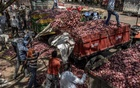 """Workers load onions onto trucks at an onion market in Lasalgaon, near Nashik, India, Apr 8, 2019. The ruling Bharatiya Janata Party has not yet delivered the """"good days"""" it promised to farm voters, who make up half of the electorate. In debt and despair, some wonder if anyone can. The New York Times"""