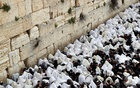 Jewish worshippers cover themselves in their prayer shawls as they pray during a priestly blessing on the Jewish holiday of Passover at the Western Wall, Judaism's holiest prayer site, in Jerusalem's Old City, Apr 22, 2019. REUTERS